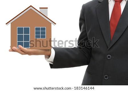 Businessman holding home model isolate on white clipping path