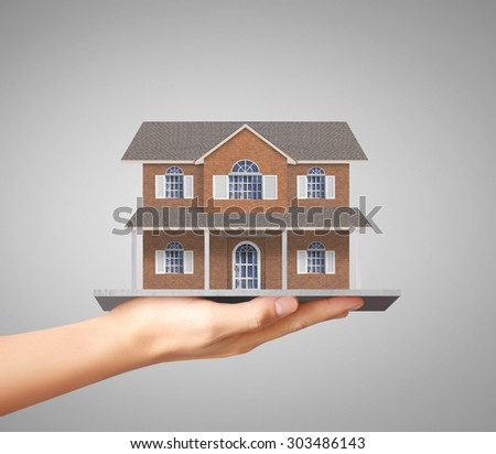 Businessman holding home model, loan concept