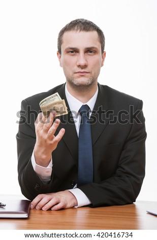 Businessman holding hundred dollars, closeup shot - stock photo