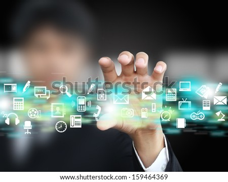 Businessman holding icon