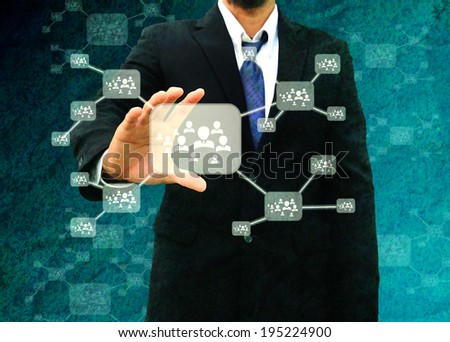 Businessman holding icon of social network in the old paper Texture  - stock photo