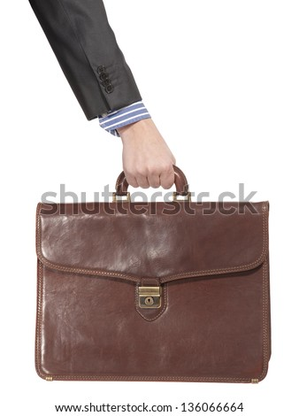 Businessman holding in hand a briefcase . Isolated on white background - stock photo