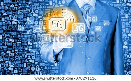 businessman holding in hand 5G, technology background - stock photo