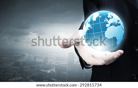Businessman holding in palm digital Earth planet