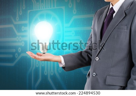Businessman holding lamp as new get idea, new thinking, power and solution on hand concept - stock photo