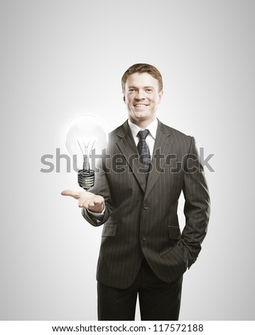 businessman holding lamp in hand
