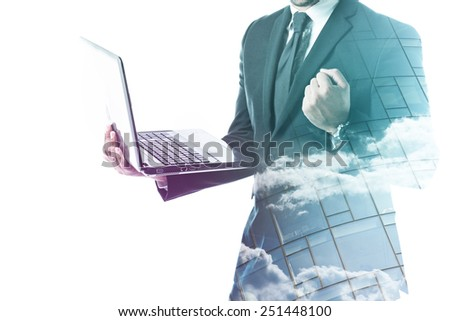 Businessman holding laptop and forming a fist double exposure isolated on white - stock photo