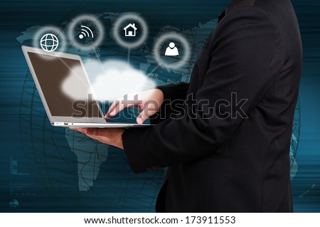 Businessman holding laptop show cloud computing concept on virtual screen.