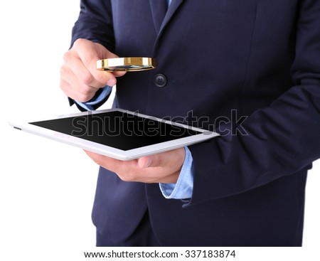 Businessman holding magnifying glass and digital tablet, isolated on white, searching and examining concept