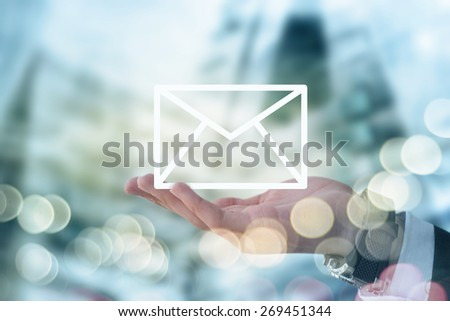 Businessman holding mail envelope - stock photo