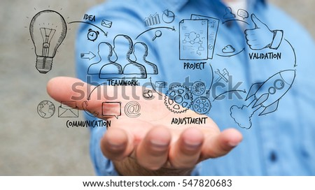 Businessman holding manuscript project presentation with his hand on blurred background