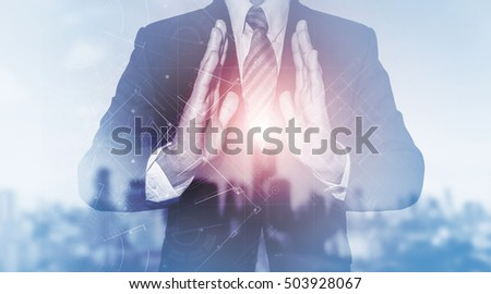 Businessman holding media architectural drawing blueprint, business new technology development