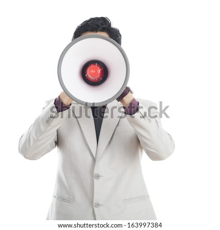 Businessman holding megaphone in front of his face