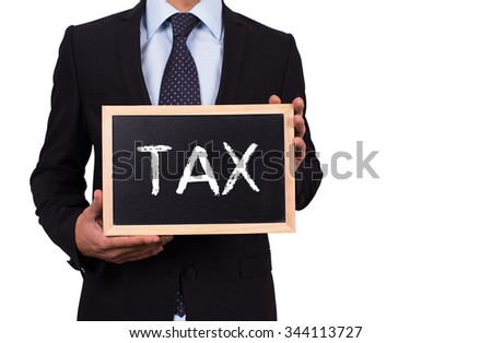 Businessman holding mini blackboard with TAX message