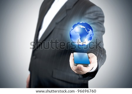 businessman holding mobile phone with globe. Concept for connectivity, internet, and email. - stock photo