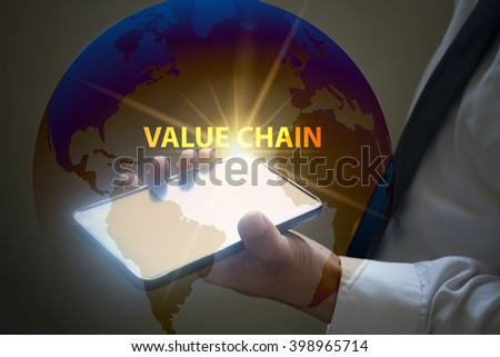 businessman holding mobile phone with VALUE CHAIN  text on virtual screen. Internet concept. Business concept.