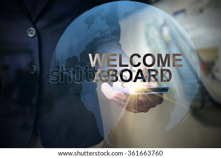 Businessman holding mobile phone with WELCOME ABOARD  text on virtual screen. Internet concept.  - stock photo