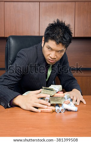 Businessman holding money - stock photo