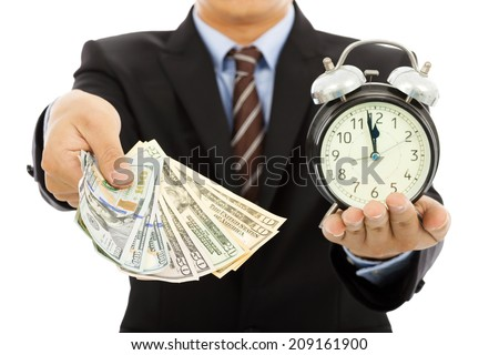 businessman holding money and clock. time is money concept - stock photo