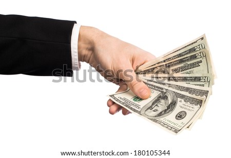 Businessman holding money in his hand isolated on white