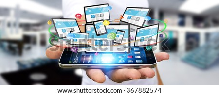 Businessman holding multimedia tech devices in his hand