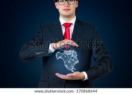Businessman Holding North America
