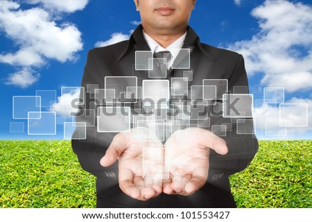 businessman holding on a touch screen interface