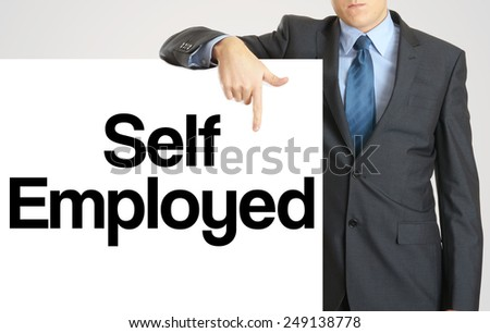 Businessman holding or showing banner with text Self Employed - stock photo