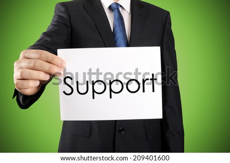 Businessman holding or showing card with Support text  - stock photo