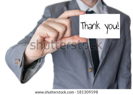 Businessman holding or showing card with thank you text - stock photo