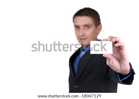 businessman holding out blank business card - focus on card