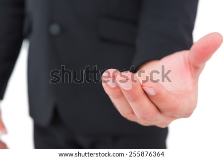 Businessman holding out his hand on white background