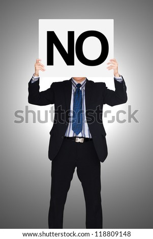 Businessman holding paper that say no