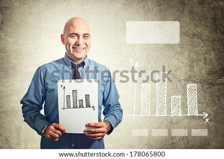 Businessman holding paper with bar chart drawing. Business situation.