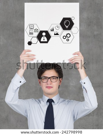 businessman holding paper with drawing business icons - stock photo