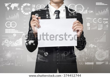businessman holding paper with graph - stock photo