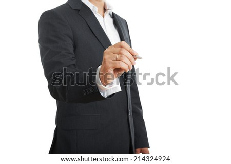 businessman holding pen over white background with empty copyspace - stock photo