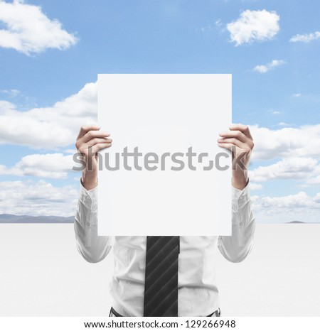 businessman holding  placard on background of sky