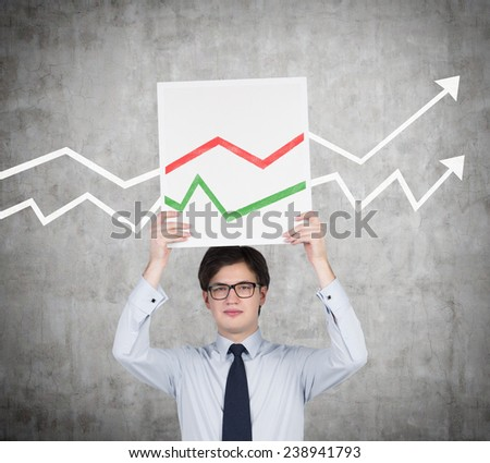 businessman holding placard with arrows on gray background