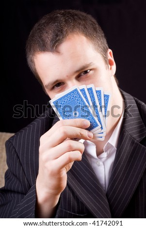 Businessman holding poker cards - stock photo