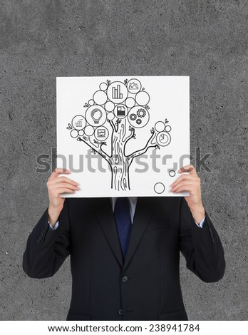businessman holding poster with money tree on gray background - stock photo