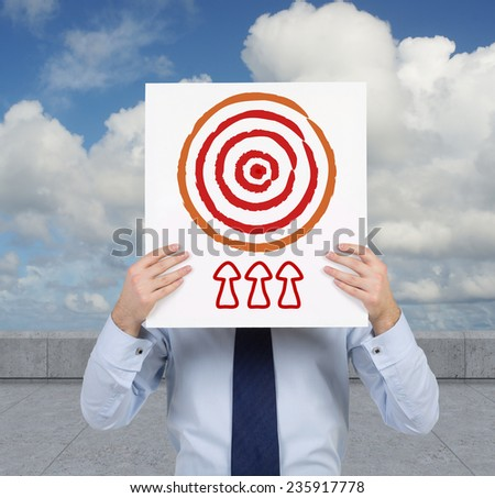 businessman holding poster with target - stock photo