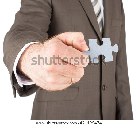 Businessman holding puzzle piece isolated on white background
