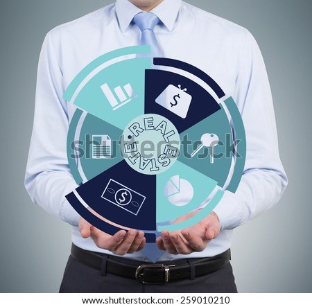 businessman holding real estate symbol on gray background - stock photo