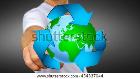 Businessman holding recycling icon and planet Earth in his hand '3D rendering'