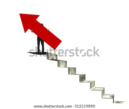 Businessman holding red arrow sign on top of money stairs, isolated on white. - stock photo