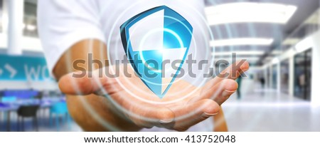 Businessman holding shield safe protection in his hand - stock photo