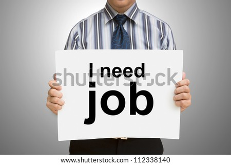 "Businessman holding sign ""I need job"" with clipping path - stock photo"