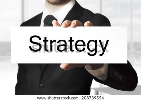 businessman holding sign strategy - stock photo