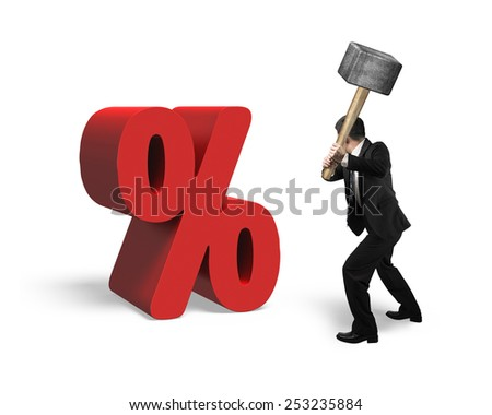 Businessman holding sledgehammer hitting red percentage sign isolated on white background - stock photo